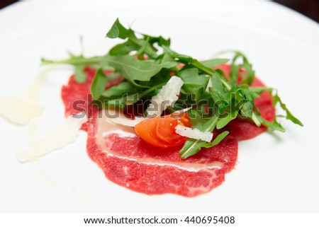 Small portion of beef carpaccio close-up