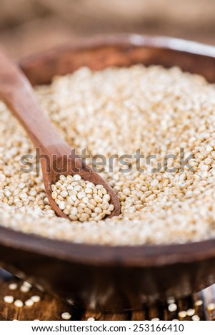 Small portion of uncooked Quinoa (close-up shot) - stock photo