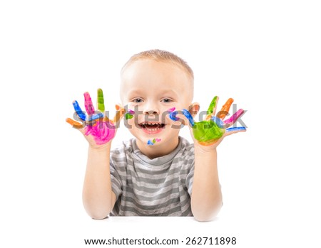 small positive boy with painted hands in bright colors. Isolate.