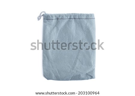 Small pouch or bag made of gray fabric with drawstring - isolated on white - stock photo
