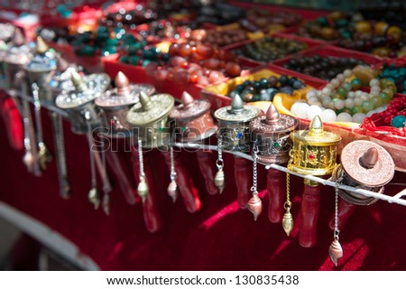 Small prayer wheels and beads - stock photo