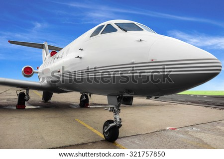 Small private aircraft at the airport parking. Closeup - stock photo