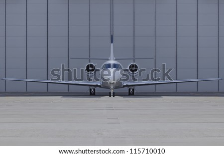 small private airplane front view - stock photo