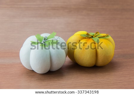 Small pumpkins on wood background - stock photo