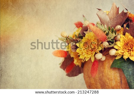 Small pumpkins with chrysanthemums