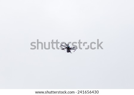Small quadrocopter against a cloudy sky. - stock photo