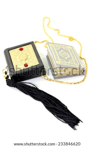 small Quran with Case before light background - stock photo