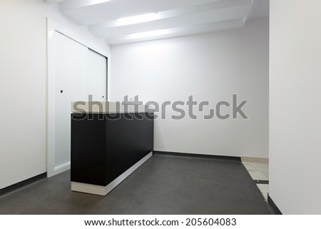 small reception area with reception desk