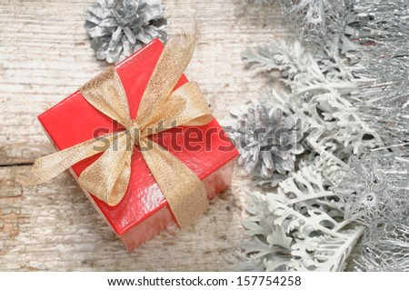 Small red box with gift for Christmas - stock photo