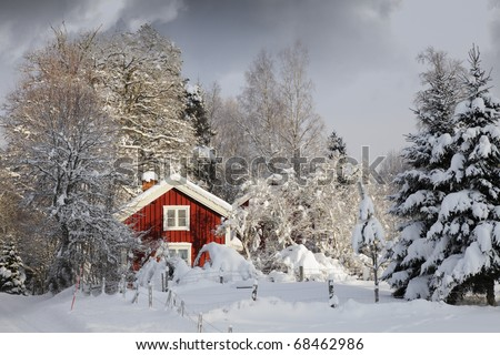 small red cottagein winter, snow and ice scenery, smaland, sweden - stock photo