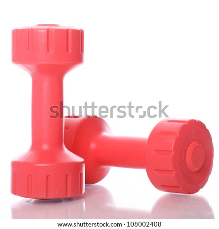 Small red dumbells over white background - stock photo