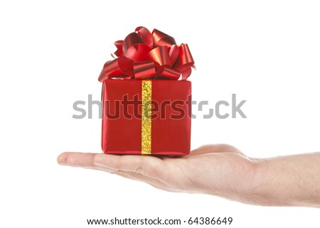 Small red gift in palm of hand. Isolated on white - stock photo