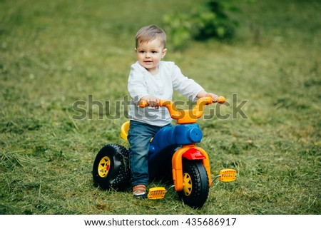 Small ride boy on bicycle