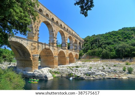 Small river and leisure boats under the Pont du Gard near Nimes, France