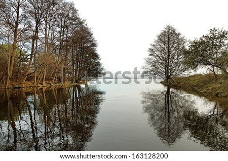 Small river is flowing to the Baltic sea. - stock photo