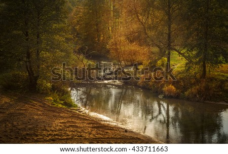 small river running through the autumn landscape