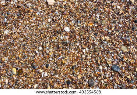 Small rocky cover the sea coast. Texture, background  - stock photo