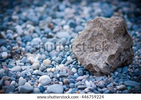 small round and sharp rocks on the shore