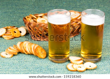 Small round mini bake rolls with a hole inside with beer - stock photo