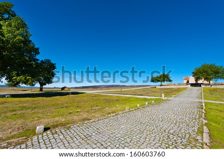 Small Rural Church on the Background of Modern Wind Turbines in Portugal - stock photo