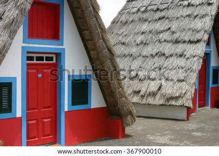 Small rural house with a triangular thatched roof.Madeira, the city of Santana - stock photo