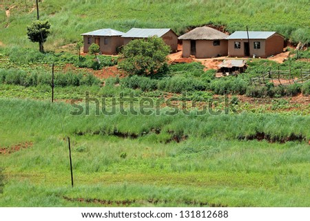 Small rural huts with cultivated lands, KwaZulu-Natal, South Africa - stock photo