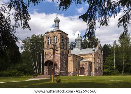 Small rural Orthodox Church. Rural church on the edge of the village. - stock photo