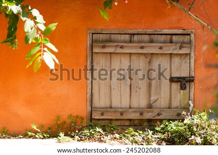 Small rustic old vintage door with padlock on pavement