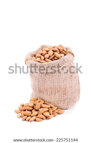 Small sack of fresh almonds isolated on white background