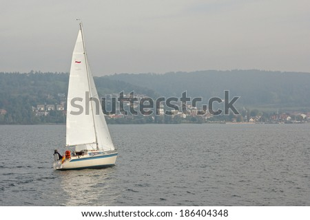 Small sail boat on Lake Constance, Germany - stock photo