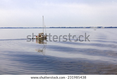 Small sailboat on the lagoon