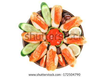 small salmon sandwiches served with vegetables
