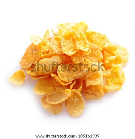 Small sampling of corn flake cereal in a pile isolated against a white background