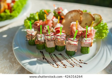 small sandwiches at the wedding - stock photo