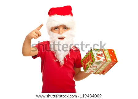 Small Santa Claus boy indicate with his finger isolated on white background