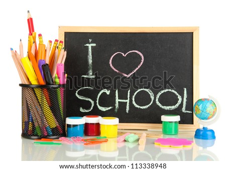 Small school desk with various school supplies close-up isolated on white - stock photo