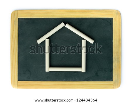 Small school wooden blank blackboard and white chalks mimicking a house, isolated on white background - stock photo