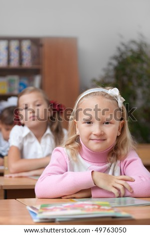 Small schoolgirl on real lesson. Elementary School