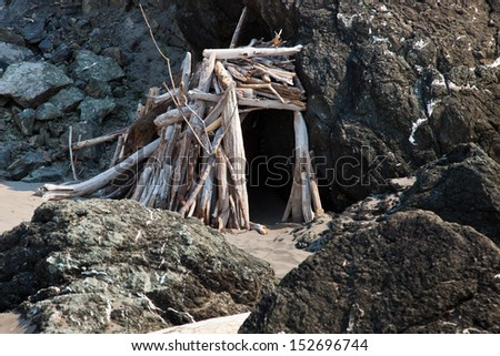 Small shack made from drift wood on the beach - stock photo