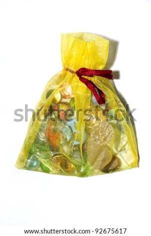 Small shiny yellow present bag with a rope