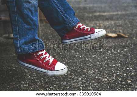 Small shod shoes on the child. The trend shoes. - stock photo