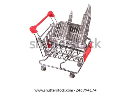 Small shopping cart isolated on white - stock photo
