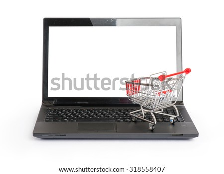 Small shopping cart on laptop on isolated white background, front view