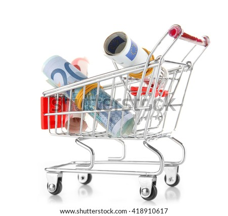 Small shopping trolley with euros banknotes isolated on white