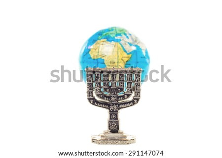 Small silver Menorah and globe in shallow DOF isolated on white background - stock photo