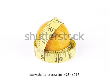 Small single satsuma with tape measure wrapped around on a reflective white background