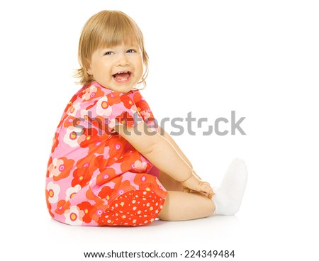 Small smiling baby in red dress - stock photo