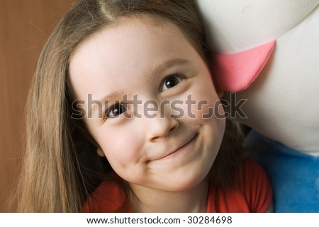 Small smiling girl with big toy