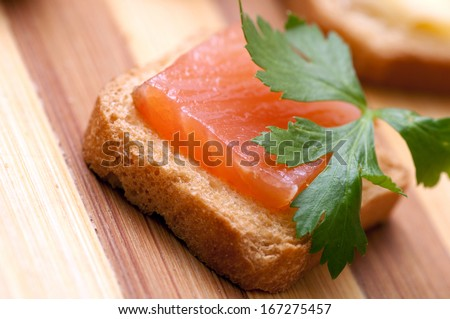 Small snack with salmon for buffet (stand-up meal, furshet) or party