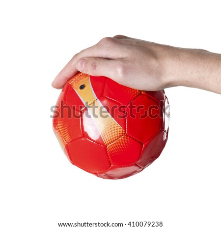small soccer red ball in hand
